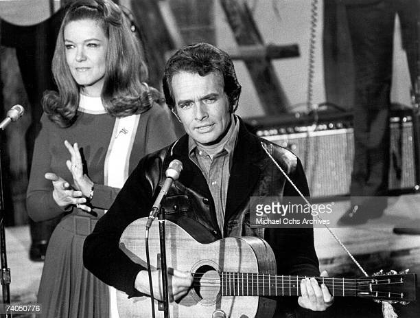 Country musician Merle Haggard performs on stage with Bonnie Owens during a late 1960's concert
