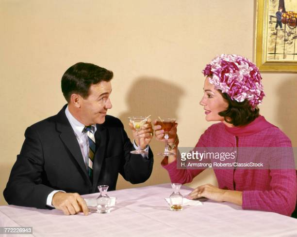 1960s COUPLE TOASTING EACH...