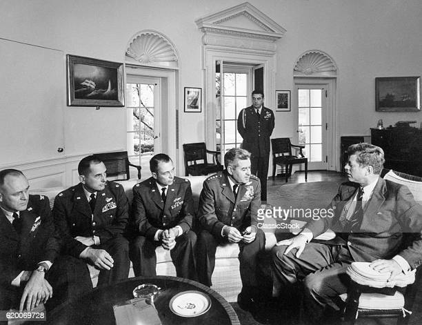 1960s CUBAN MISSILE CRISIS OCTOBER 1962 PRESIDENT JOHN F KENNEDY WITH GENERAL CURTIS LEMAY AIDES DISCUSSE SURVEILLANCE OF CUBA