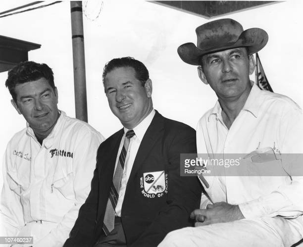 Driver Curtis Turner former Indy 500 winner and ABCTV commentator Rodger Ward and car owner/master mechanic Smokey Yunick chat at a NASCAR Cup event...