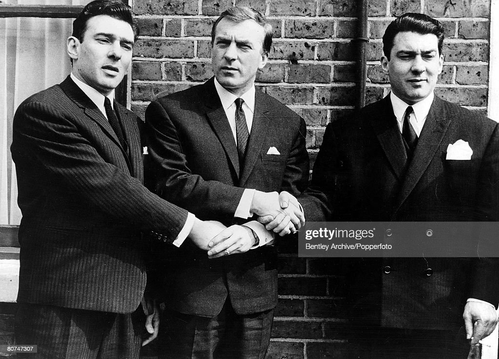 1960s East End London gangsters the Kray Brothers hold hands They are from left to right: Ronnie, Charlie, and Reggie. : News Photo