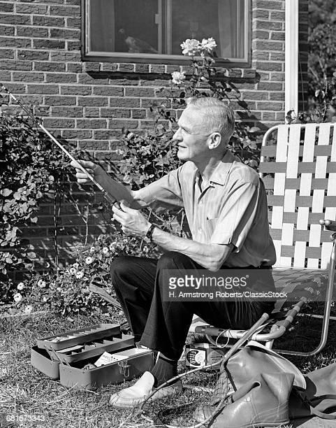 1960s ELDERLY MAN SEATED...