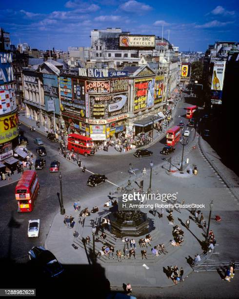 1960s Elevated View Piccadilly Circus In West End Of London England Many Neon Signs Advertising Shaftesbury Fountain In Center