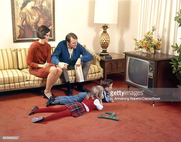 1960s FAMILY IN LIVING ROOM WATCHING TV FATHER MOTHER SISTER BROTHER