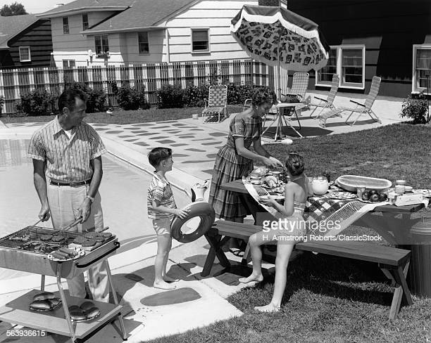 1960s FAMILY OF 4 IN...