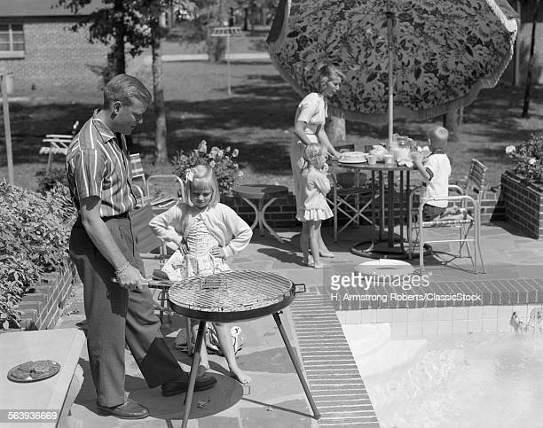 1960s FAMILY OF 5 ON THE...