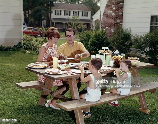 1960s FAMILY OF FOUR AT...