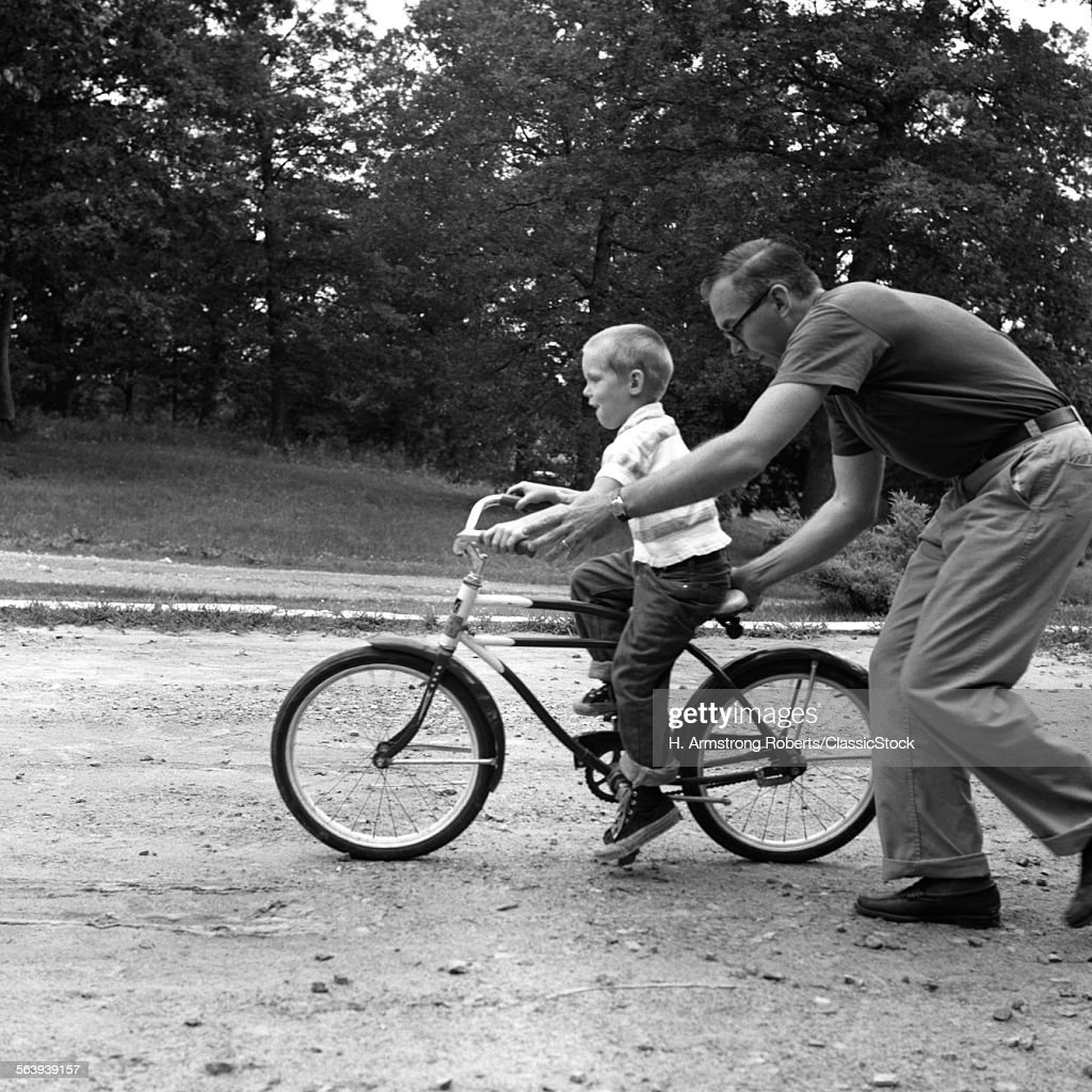 1960s FATHER GIVING SON ON... : Stock Photo