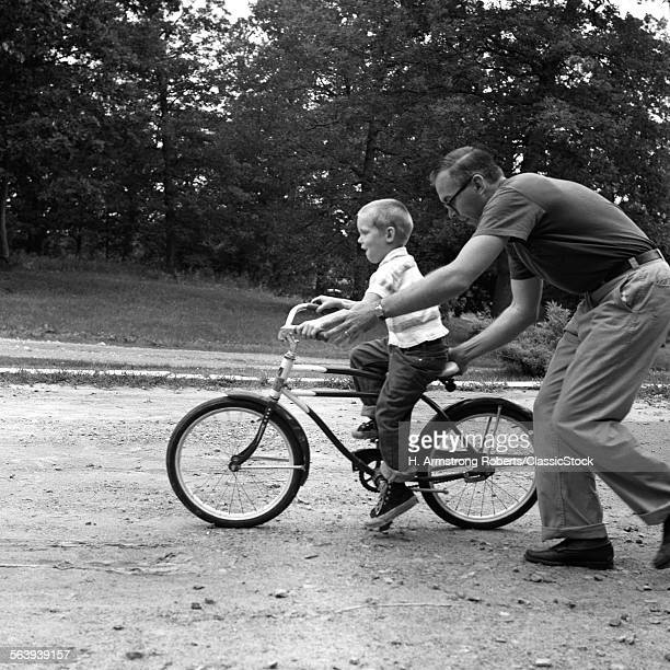 1960s FATHER GIVING SON ON...
