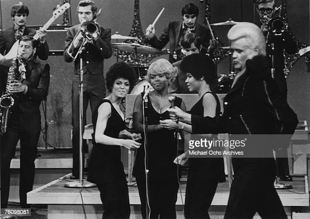 Flamboyant soul singer Wayne Cochran performs with his backing group the C.C. Riders circa the late-1960s.