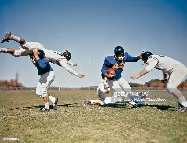 1960s FOOTBALL PLAYER...