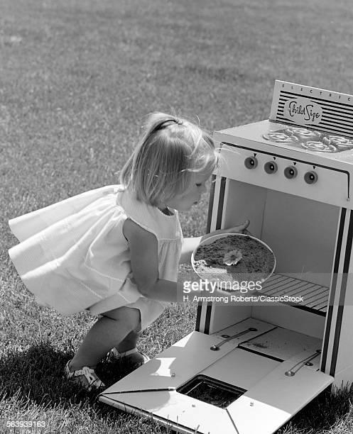 1960s GIRL IN YARD...
