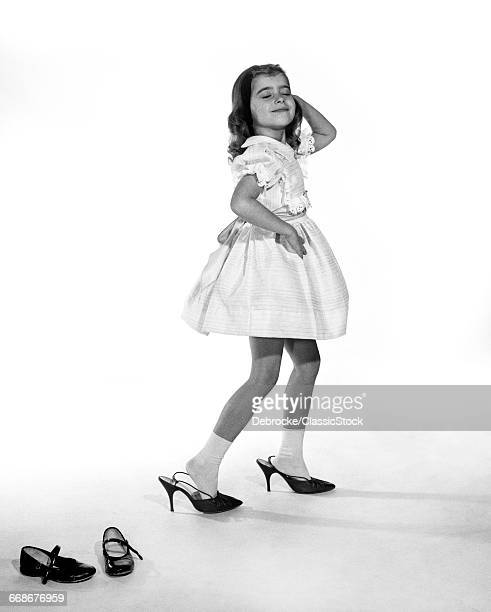 1960s GIRL MAKING GLAMOUR...