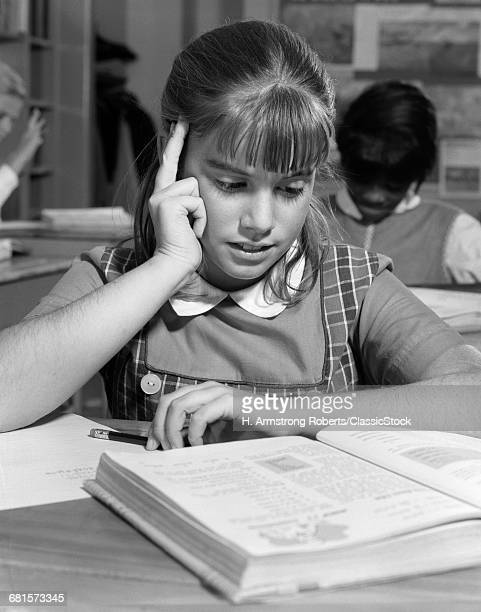 1960s GIRL READING BOOK IN...