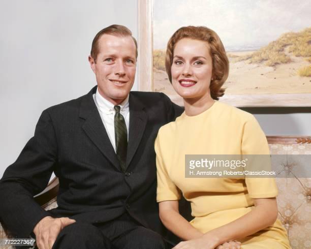 1960s HAPPY COUPLE SITTING...