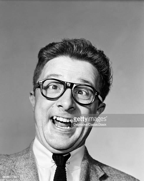 1960s LAUGHING MAN WEARING...