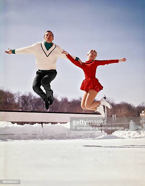 1960s MAN AND WOMAN ICE...
