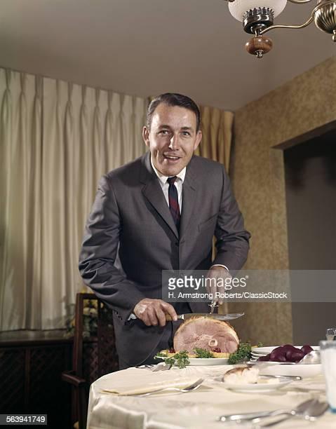 1960s MAN CARVING HAM...