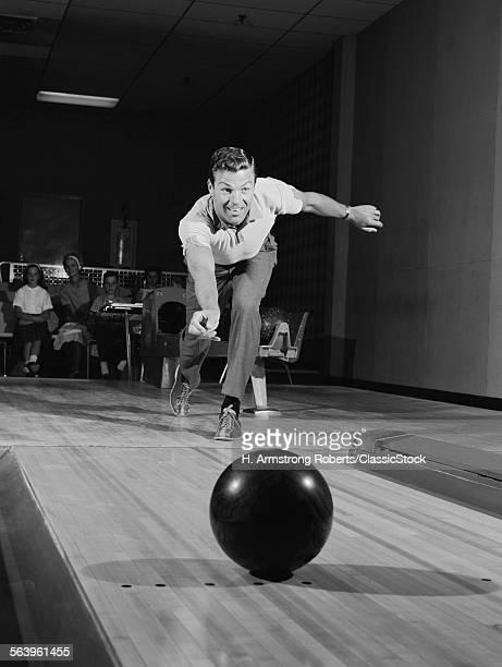 1960s MAN RELEASING BALL...