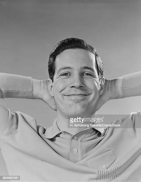 1960s MAN SMILING RELAXING...