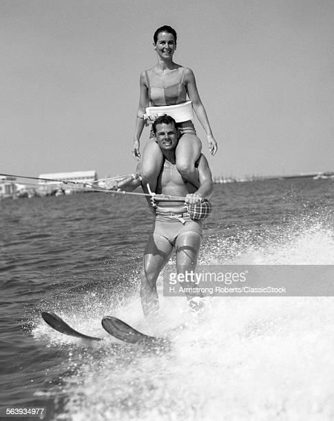 1960s MAN WATER SKIING...