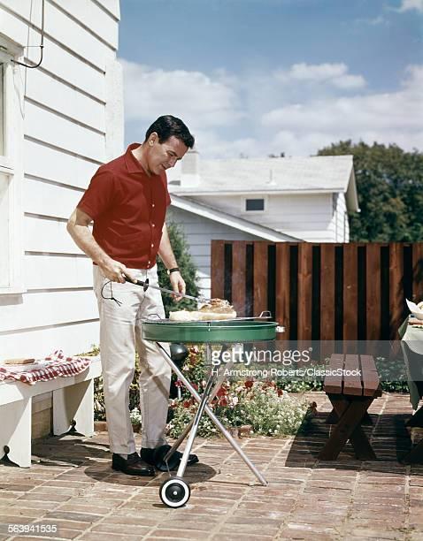 1960s MAN WEARING RED...