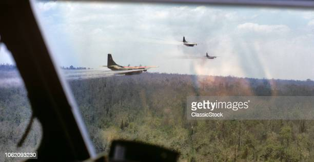1960s MARCH 1969 OPERATION RANCH HAND USAF UC123B PROWLER AIRCRAFT SPRAYING AGENT ORANGE DEFOLIANT SOUTH VIETNAM