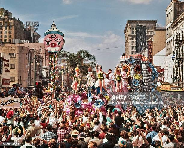 1960s MARDI GRAS REX PARADE ON CANAL STREET FEBRUARY 14 1961 CROWD REACHING FOR TRINKETS NEW ORLEANS LA USA