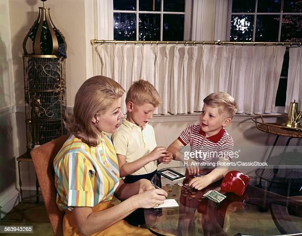 1960s MOTHER WOMAN TWO BOYS SONS COUNT MONEY PIGGY BANK BUDGET ALLOWANCE