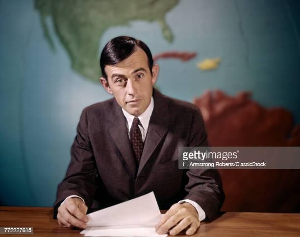 1960s NEWSMAN LOOKING AT...