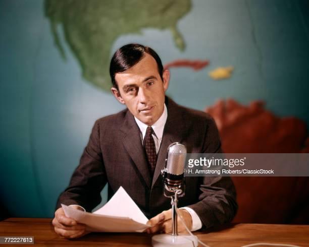 1960s NEWSMAN READING NEWS...