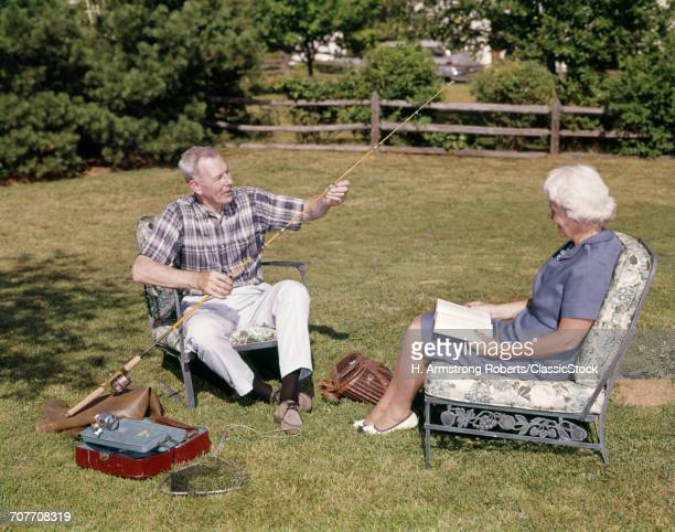 1960s OLDER COUPLE SITTING...