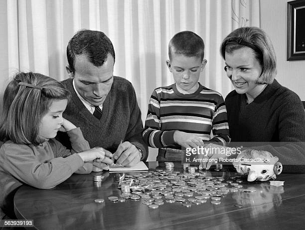 1960s PARENTS SEATED AT...