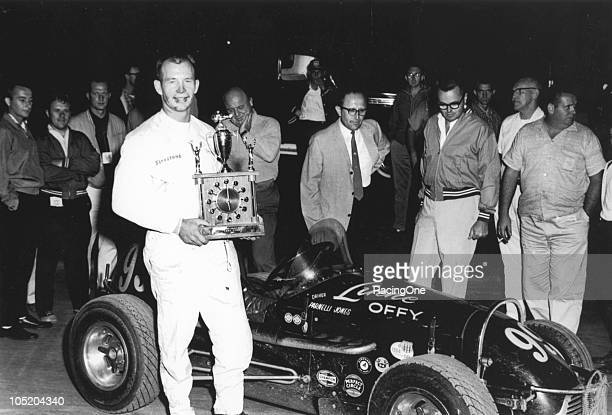 Parnelli Jones poses with a combination trophy and clock after winning a Midget race in the Linne Offenhauser in the early 1960s Promoter Hilly Rife...