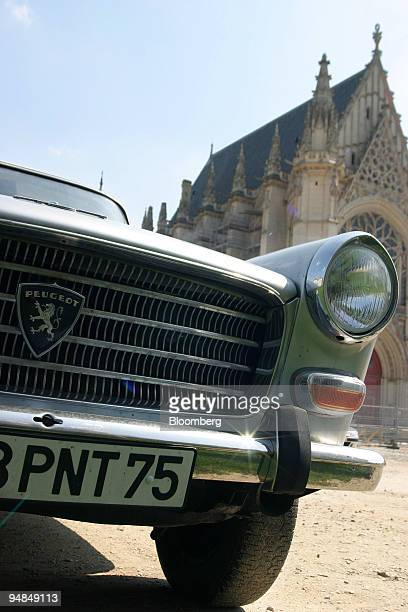 A 1960s Peugeot 404 automobile is seen in Vincennes near Paris France Monday April 12 2004 Western European car sales fell in October for a fourth...