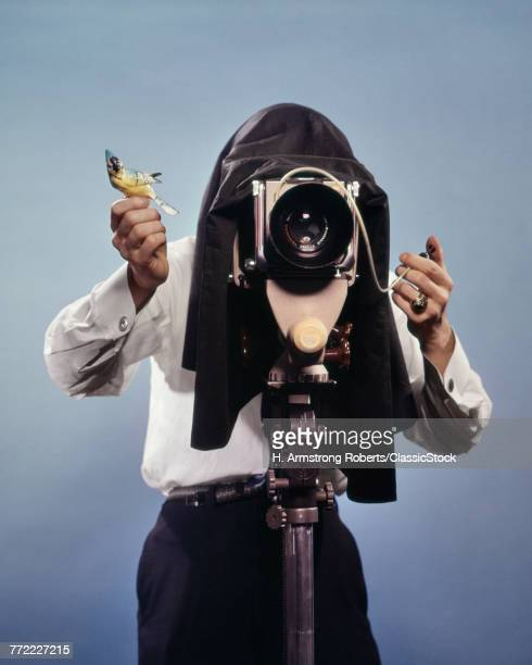1960s PHOTOGRAPHER BEHIND...