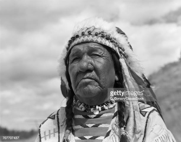 1960s PORTRAIT NATIVE AMERICAN MAN CHIEF BLACKFOOT INDIAN TRIBE IN BROWNING MONTANA