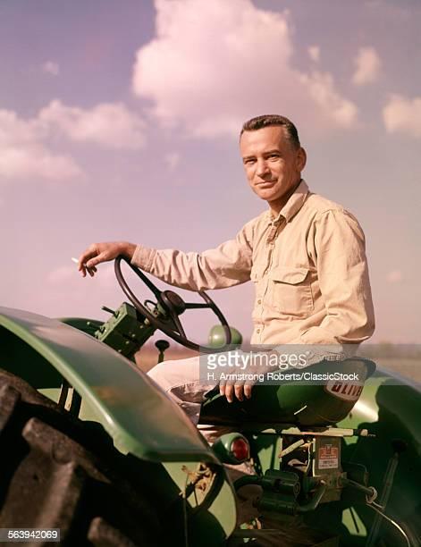 1960s PORTRAIT SMILING MAN...
