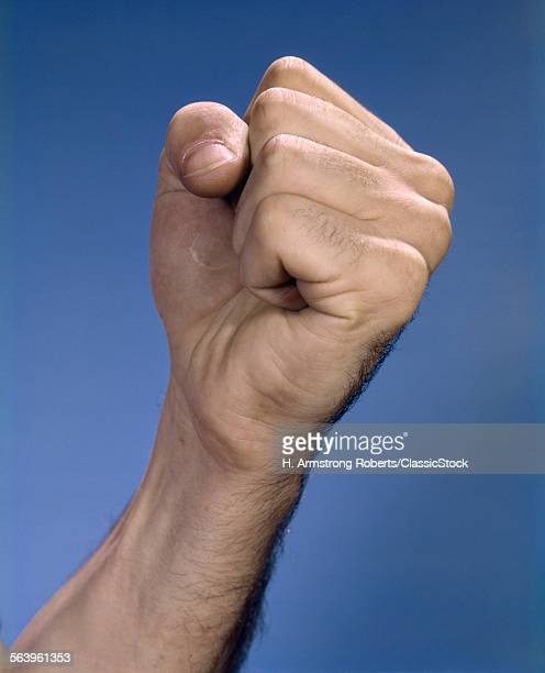 1960s RAISED MALE FIST