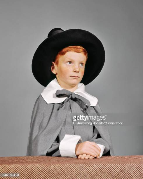1960s SERIOUS BOY DRESSED IN PILGRIM CLOTHES COSTUME FOR THANKSGIVING SCHOOL PLAY