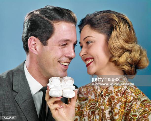 1960s SMILING COUPLE HEADS...