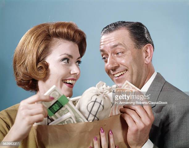 1960s SMILING COUPLE MAN WOMAN