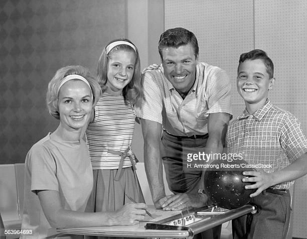 1960s SMILING FAMILY OF 4...