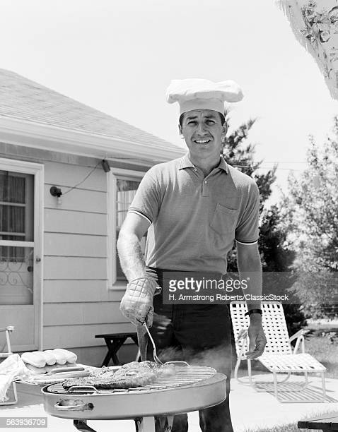 1960s SMILING MAN OUTDOORS...