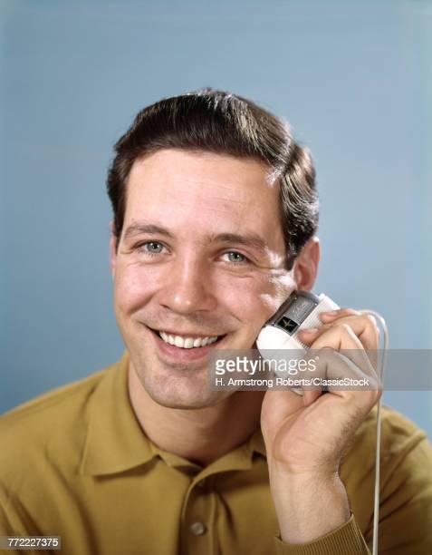 1960s SMILING MAN SHAVING...