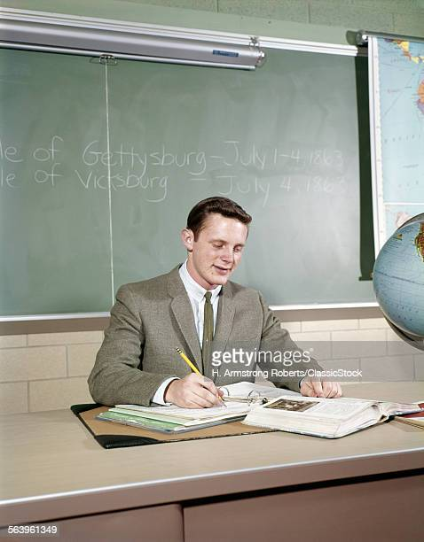 1960s STUDENT STUDYING...