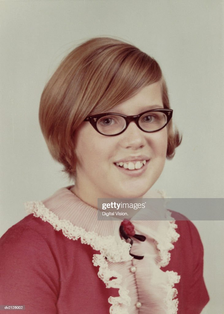 1960s Studio Portrait of a Young Girl With Spectacles : Stock Photo