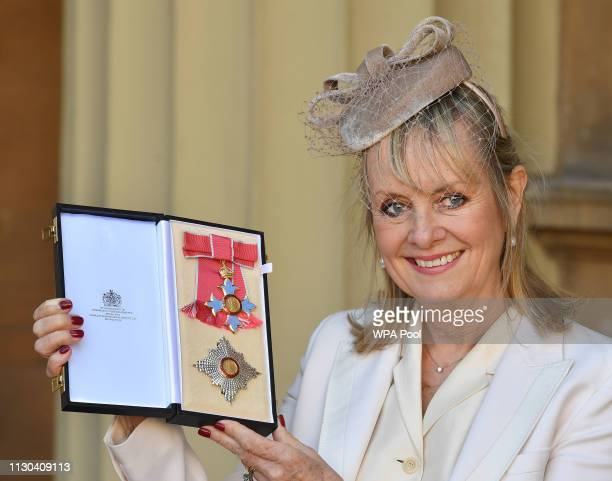 """1960s supermodel Lesley """"Twiggy"""" Lawson holds her Dame Commander of the Order of the British Empire award for services to fashion, the arts and..."""