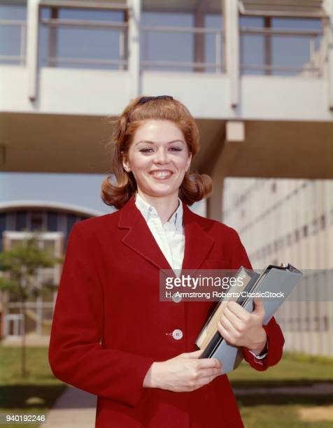 1960s TEEN GIRL HOLDING...