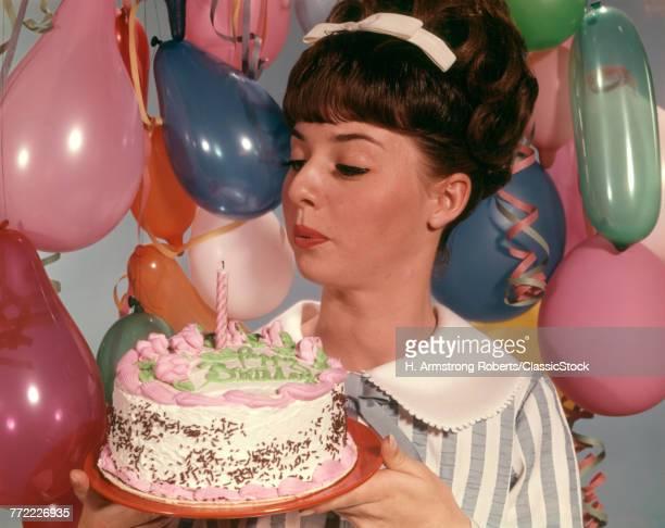 1960s TEENAGE GIRL BLOWING...